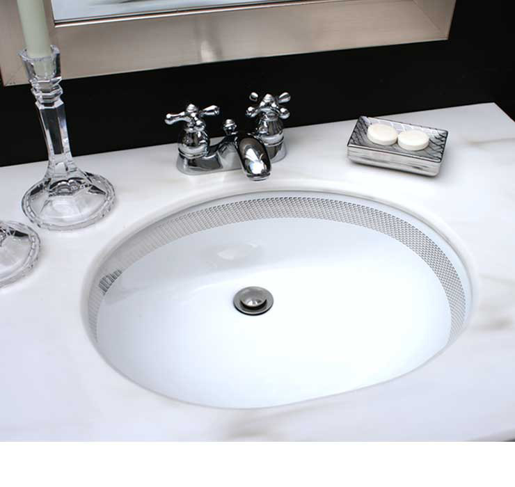 black and white bathroom with hand painted border basin