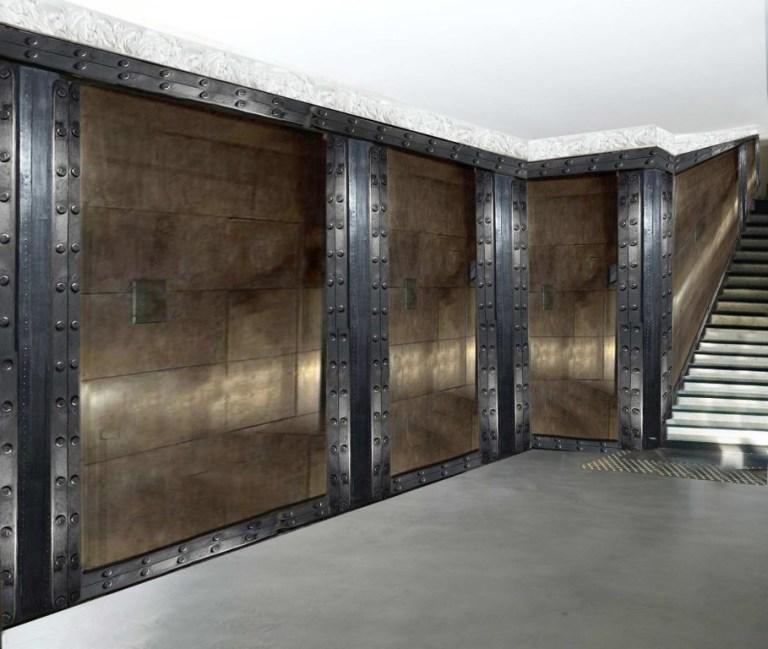 comptoir de bar professionnel murs métal et IPN de style Eiffel avec le béton décoratif Résinence