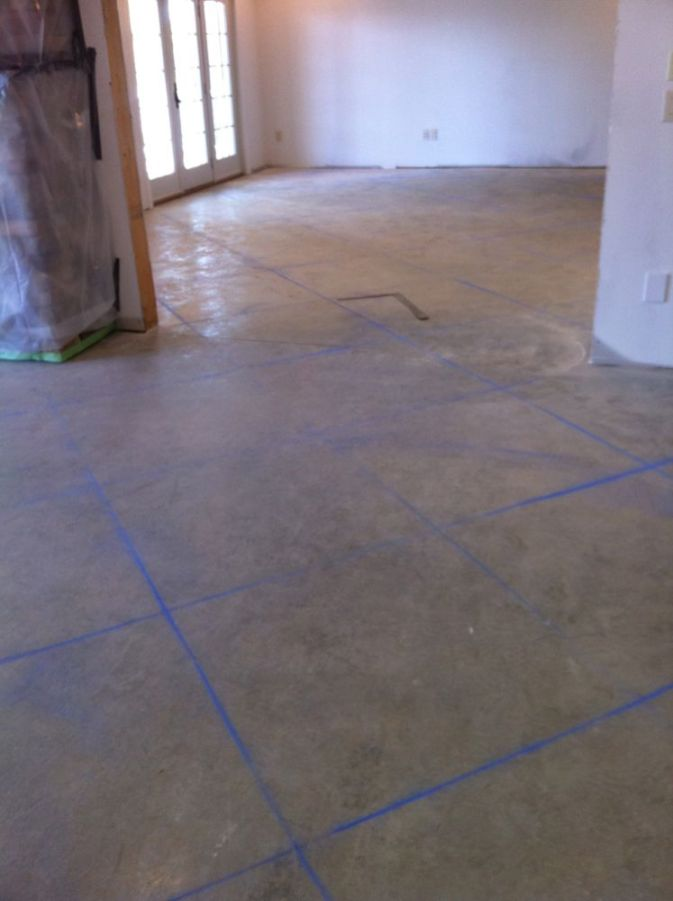 Laying out the pattern for lines to be scored into the concrete floor