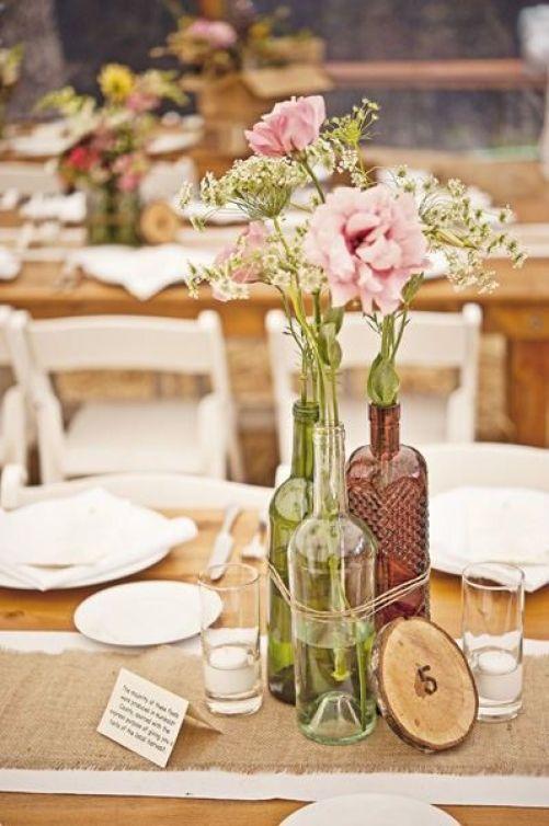 enfeite de mesa com garrafa de vidro
