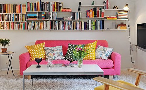 pink sofa in the small flat