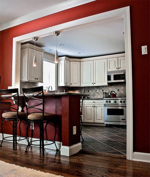 red wall kitchen white cabinet