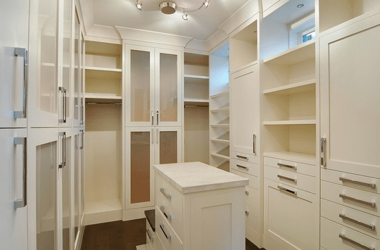 closets - walk-in closet  walk-in closet!   Ivory cabinets and shelves with chrome modern pulls.