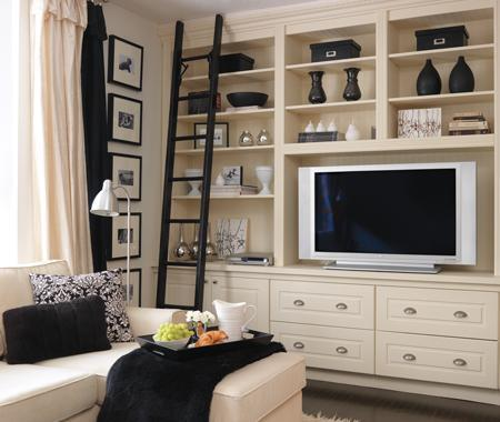 media rooms - ivory sectional chaise lounge black velvet pillow throw chrome pharmacy floor lamp black rolling library stairs ivory black window treatments drapes black white photo gallery ivory built-ins cabinets shelves entertainment center black vases accents ivory shag rug