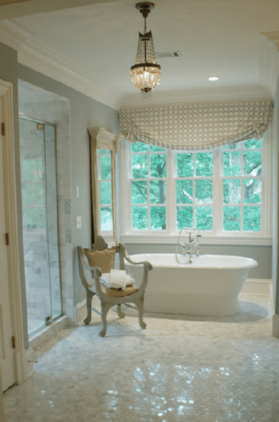bathrooms - white carrara polished marble tiles floors tub gray chair geometric gray window valance crystal chandelier blue green walls paint color bathroom