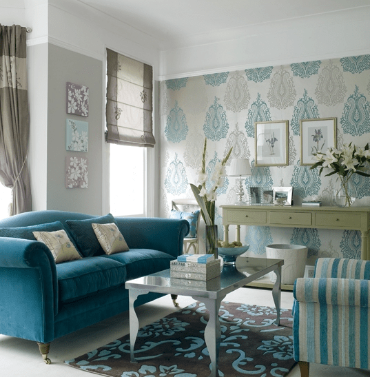 living rooms - Villa Nova Wallpaper Laura Ashley Sofa Argos Rug Ikea Coffee Table Ikea cofee table turquoise sofa velvet sofa classic modern console wallpaper roman shade grey drapes stripes cut velvet tufted rug silver blue living room