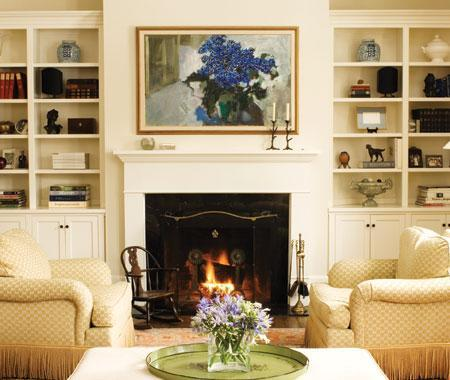 living rooms - Built-ins fireplace cream shelves  Beautiful built-ins next to the fireplace.    Rolled arm chairs, fireplace and built-ins cabinets