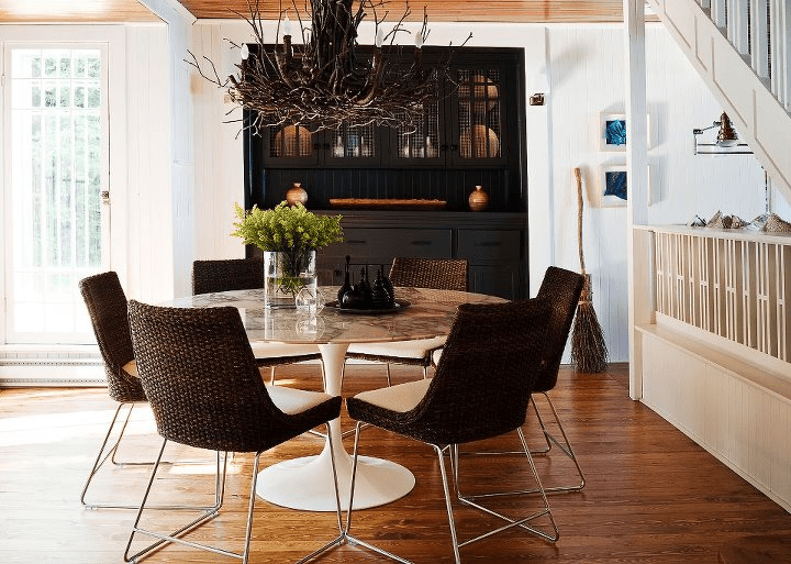 Jennifer Worts Design - Marble Saarinen tulip table, espresso wicker chairs, branch ...