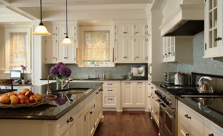 kitchens - blue gray glass subway tiles backsplash ivory glass-front cabinets oil rubbed bronze hardware black granite countertops bamboo roller shades