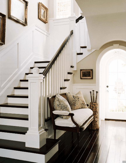 entrances/foyers - glossy ebony floors bench wainscoting staircase gold gilt vintage frames art tan gray walls  Joe Schmelzer Photography!  gorgeous