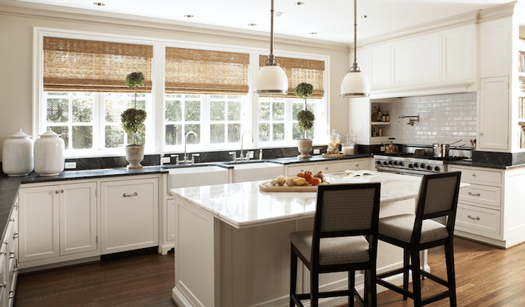 kitchens - topiaries bamboo roman shades farmhouse sinks white calcutta black marble countertops pot filler subway tiles backsplash creamy white kitchen cabinets pendants lighting