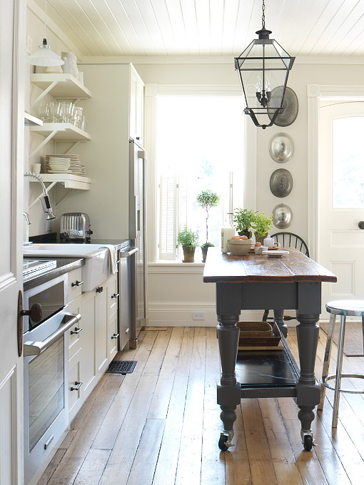 kitchens - charcoal gray kitchen island butcher block countertop iron glass lantern pendant white kitchen cabinets farmhouse sink open shelves