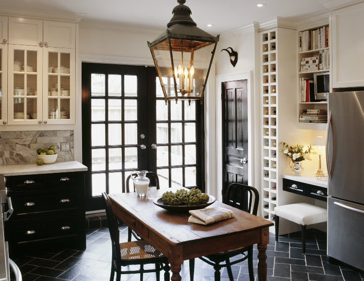 kitchens - glossy black French doors black lower cabinets white upper cabinets black tiles herringbone chevron pattern white carrara marble countertops subway tiles backsplash rustic farmhouse table black cafe chairs black lantern built-in wine rack desk