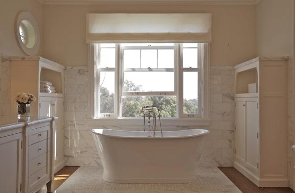bathrooms - freestanding tub beadboard calcutta marble backsplash countertops ivory bathroom cabinet vanity  Brooke Giannetti.  freestanding