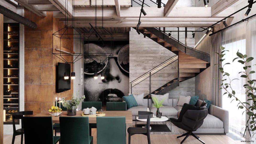 Dans Lu0027espace De Vie Ouvert, Un Canapé Moderne Gris Permet De Faire Un  Rappel Avec La Teinte Béton Qui A été Posée Sur Le Mur Adjacent.