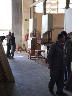 """Mohammad Mamduh from the modern factory """"Pinocchio"""" in New Damietta explains the work processes to Mohammad Abotera (DEDI)."""