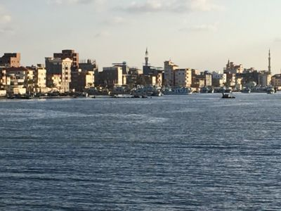 The Nile enters the Mediterranean approximately ten kilometers north of Damietta at Ras al-Barr.