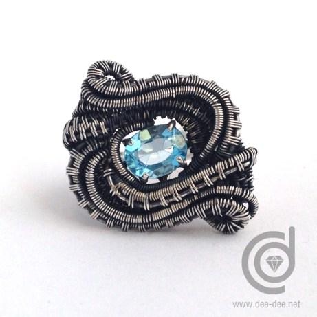 anel de prata e topazio