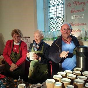Volunteers in the St Mary's Church at Deepdale Christmas Market 2018