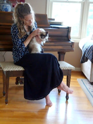 A Portrait Of Feminine Dress, Pt 2 Mix-N-Match, tops and skirts, feminine, modest, bright colors, woman holding cat at grand piano, barefoot lady