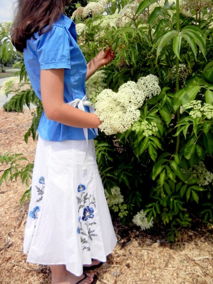 A Portrait Of Feminine Dress, Pt 2 Mix-N-Match, tops and skirts, feminine, modest, bright colors, woman, elderberry plant, flowers, white, picking bouquet