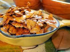 10 Top Health Benefits of Pumpkin Seeds, roasted seeds, baking pumpkins, sweet and spicy snack, crunchy snack, kid-friendly, saving pumpkin seeds, roasting, baked pumpkin, healthy snacks, crunchy, honey roasted, cayenne, squash seeds, recipe, tasty, four year old, gobble, healthy benefits, magnesium, heart-healthy, recommended daily allowance, ATP, adenosine triphosphate, energy, RNA, DNA,blood pressure, cardiac arrest, heart attack, stroke, deficient, source of, zinc, mineral depleted soils, plant-based diet, paleo, raw nuts and seeds, Plant-Based Omega-3 Fats, alpha-linolenic acid, ALA, prostate health, men's health, enlarged prostate, research, anti-diabetic effect, antioxidants, fiber, tryptophan, restful sleep, amino acid, protein building block, anti-inflammatory, pumpkin seed oil, alkaline-forming seed, tapeworms, parasites, organic, freshness, Himalayan salt, natural sea salt, instructions, snack, portable snack, grow pumpkins, nutrition, Thomas Edison, quote, cure, prevent disease, spicy, honey-roasted,
