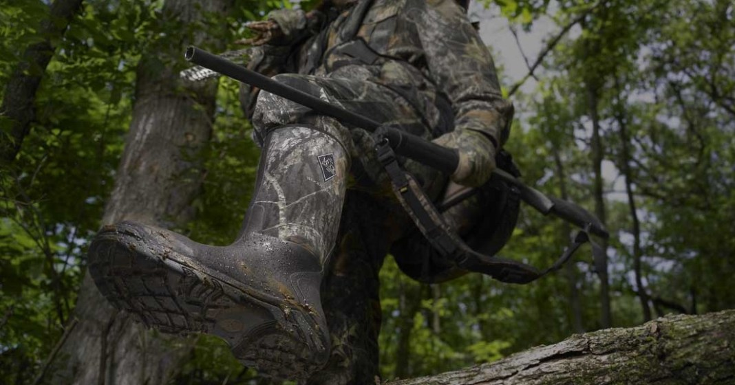 photo of the best hunting boots under $150 stepping over a log