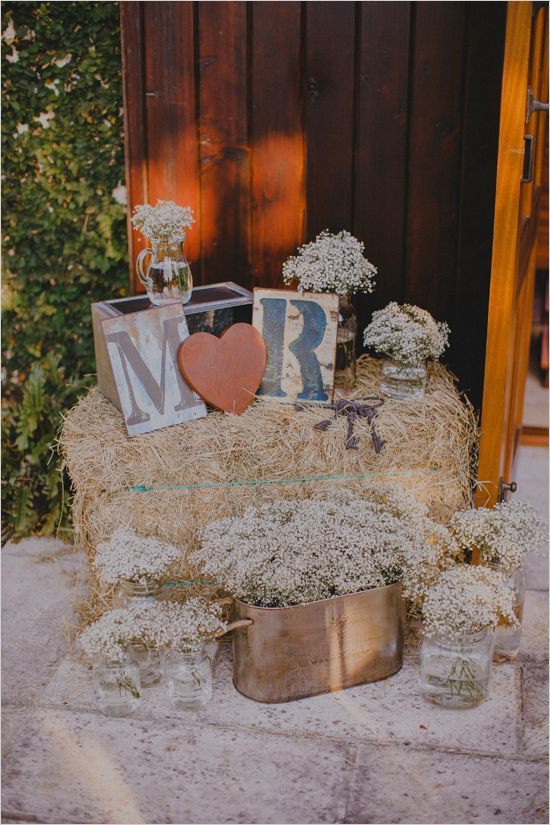 rustic hay bail and babys breath decor