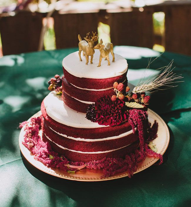 rustic deep red naked wedding cake with gold deers cake toppers     rustic deep red naked wedding cake with gold deers cake toppers