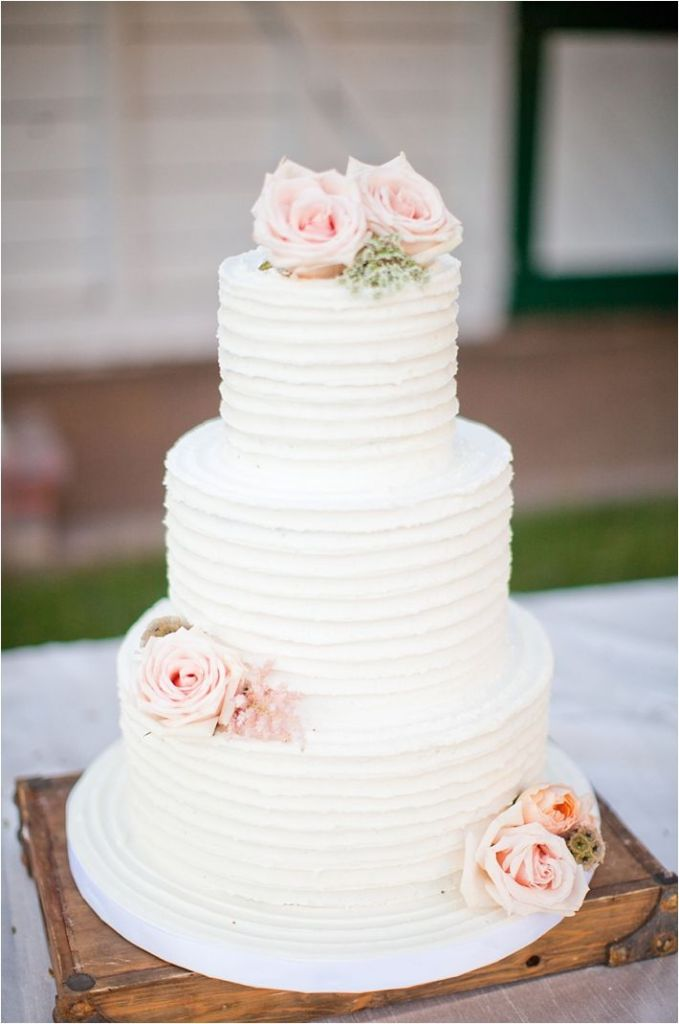 25 Buttercream Wedding Cakes We d  Almost  Kill For  with Tutorial         Rustic white wedding cake with blush roses Ivory and Rose Buttercream