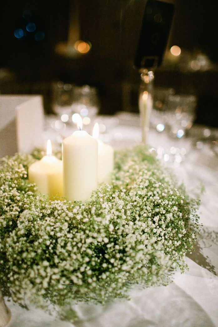 Lots of candles + LOTS of baby's breath