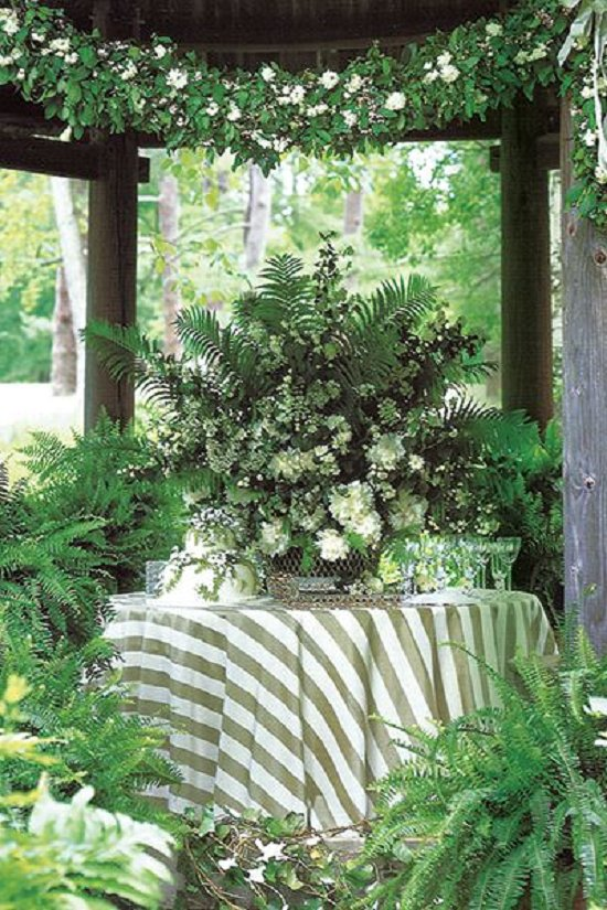 Adelicate Cake Nestled Beneath A Centerpiece Of Ferns