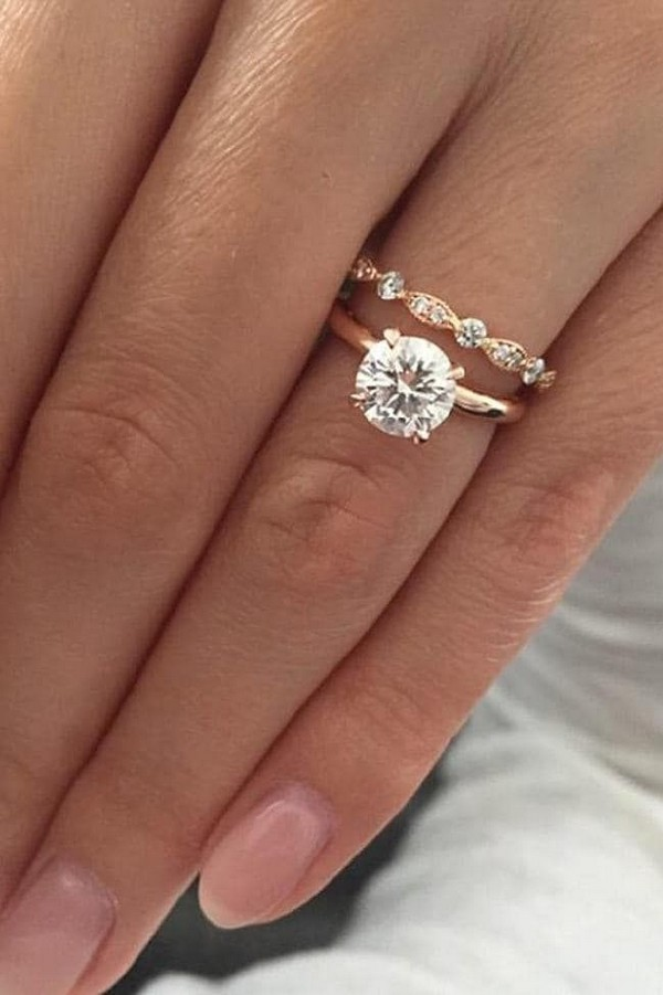 Art deco engagement ring with rose gold ribbon