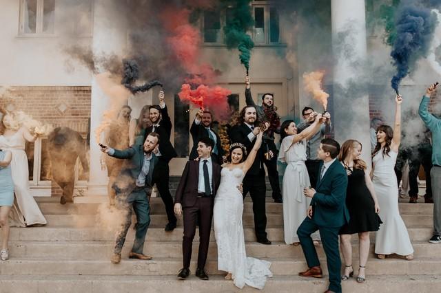 group of wedding photo with colorful smoke bombs