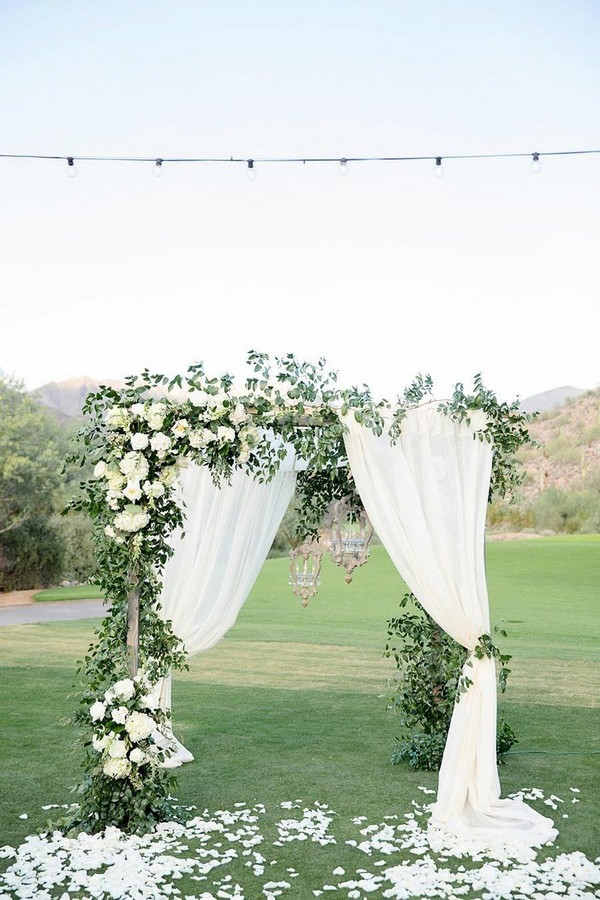 outdoor greenery wedding arch