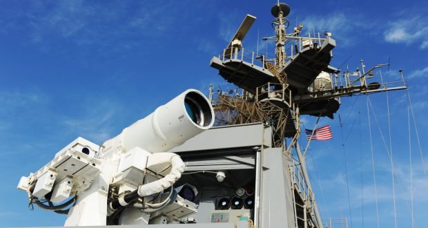 """Raytheon Co., one of the world's largest defense contractors, has been awarded a $13,1 million U.S. Air Force contract modification for High Energy Laser Weapon Systems (HELWS). The modification to the previously awarded contract covers the purchase of one additional HELWS being produced under the basic agreement, including outside continental U.S. (OCONUS) field assessment for purposes of experimentation. The U.S. Department of Defense said Thursday that work will be performed at OCONUS locations and is expected to be completed by Nov. 1, 2020. The total cumulative face value of the agreement is $36,939,636. Raytheon's HELWS uses pure energy to detect, identify and instantly take down drones. It can target a single drone with precision. The HELWS is paired with Raytheon's Multi-spectral Targeting System. It uses invisible beams of light to defeat hostile UASs. Mounted on a Polaris MRZR all-terrain vehicle, the system detects, identifies, tracks and engages drones. """"Every day, there's another story about a rogue drone incident,"""" said Stefan Baur, vice president of Raytheon Electronic Warfare Systems. """"These threats aren't going away, and in many instances, shooting them with a high energy laser weapon system is the most effective and safest way to bring them down."""" The U.S. Air Force expected that new Raytheon's laser weapon system will identify, tracks, and defends against enemy unmanned vehicles and other """"close-in"""" defense situations. According to the current information, the Raytheon's system is standalone, with a footprint of roughly 30 square feet. On a single charge from a standard 220v outlet, the same kind you plug your washing machine into at home, the HEL system onboard the light vehicle or buggy delivers four hours of intelligence, surveillance and reconnaissance capability and 20 to 30 laser shots. The system can also be coupled with a generator to provide virtually infinite magazine depth. The contract follows successful demonstrations of Raytheon's di"""