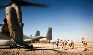 Senator Lindsey Graham, a senior senator from South Carolina, makes his way onto an MV-22 Osprey at the end of a visit to Nawa, Afghanistan, Nov. 11, 2010. Graham, along with Senators John McCain, a senior senator from Arizona, Kirsten Gillibrand, a junior senator from New York, and Joseph I. Lieberman, a junior senator from Connecticut, visited Marines of 3rd Battalion, 3rd Marine Regiment, where they toured Khalaj High School, the Nawa District bazaar and the Nawa District Governance Center as well as meeting with Nawa government officials. U.S. Marine Corps photo by Sgt. Mark Fayloga