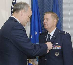 Lt. Gen. Jack L. Rives, Air Force judge advocate general, pins the Meritorious Service Medal on Col. Lindsey Graham in a Pentagon ceremony April 28, 2009. In addition to being a U.S. senator from South Carolina, Colonel Graham is an individual mobilization augmentee and the senior instructor at the Air Force JAG School at Maxwell Air Force Base, Ala. U.S. Air Force photo