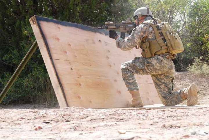 A Green Beret from 3rd Battalion, 10th Special Forces Group (Airborne), maneuvers through an obstacle course with his SCAR during Special Forces Advanced Urban Combat training Fort Carson, Colo., Sept. 15. USASOC Photo by Staff Sgt. Michael R. Noggle