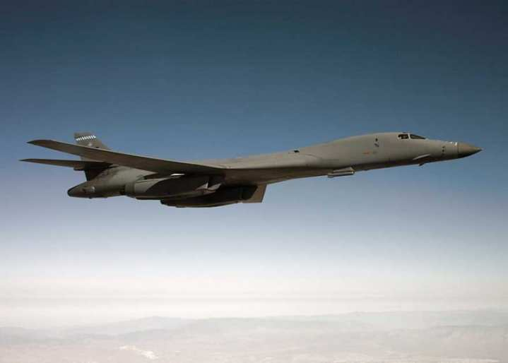 A B-1B Lancer flies on a testing mission carrying a Sniper pod over Edwards Air Force Base, Calif. The Sniper pod has helped give the Bone a new lease on life. U.S. Air Force photo/Jet Fabara