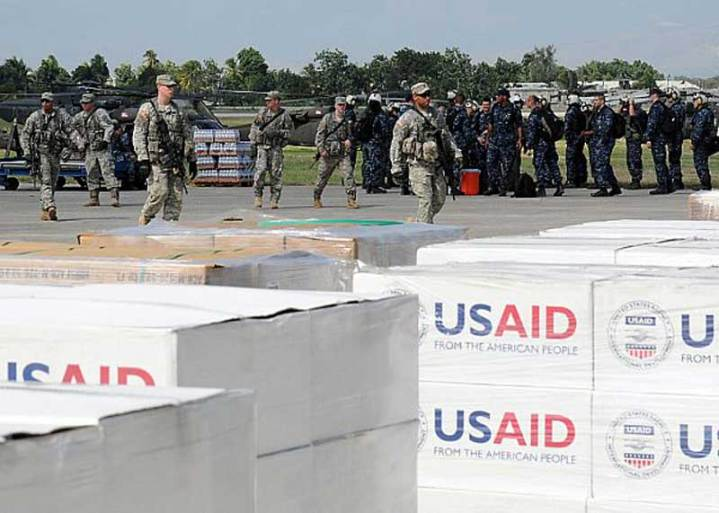At the airport in Port-Au-Prince, Haiti, sailors from USS Carl Vinson (CVN 70) and soldiers from the U.S. Army's 82nd Airborne Division prepare for transit of relief supplies on Jan. 17, 2010. The U.S. military moved quickly to conduct humanitarian and disaster relief operations as part of Operation Unified Response after a 7.0 magnitude earthquake caused severe damage in Haiti Jan. 12, 2010. U.S. Navy photo by Mass Communication Specialist 2nd Class Candice Villarreal
