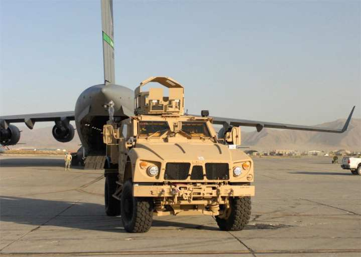 A Mine-Resistant, Ambush-Protected All-Terrain Vehicle (M-ATV) sits on the tarmac at Bagram Airfield, Afghanistan, Oct. 1, 2009, after being offloaded from a C-17 Globemaster III less than a day after leaving Charleston Air Force Base, S.C. This M-ATV was among the first of its kind in Afghanistan and supports small-unit combat operations in highly restricted rural, mountainous and urban environments that include mounted patrols, reconnaissance, security, convoy protection, communications, command and control, and combat service support. The M-ATV is designed to replace the up-armored Humvee in Afghanistan. While M-ATV procurement moves ahead at full speed, attempts to kill further C-17 procurement continue. U.S. Air Force photo by Senior Airman Susan Tracy