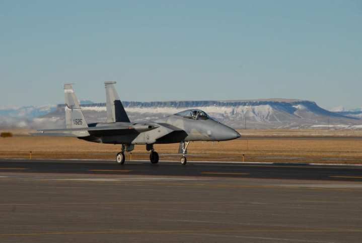 "Snow-capped mountains in the background are routine for the ""Big Sky Country"" F-15C Eagles of the 186th Fighter Squadron ""Vigilantes,"" stationed at Missoula, Mont. Beginning August 6, a detachment of the 186th squadron will be working in the tropics as the unit defends the skies of Hawaii. Montana ANG via Robert F. Dorr."