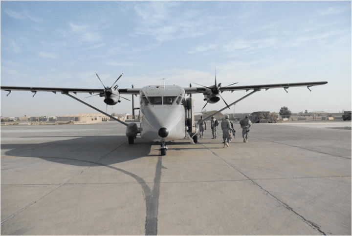 An Operational Support Airlift Agency (OSAA) Shorts C-23C Sherpa disgorges armed troops at Kandahar Air Base, Afghanistan in 2010. Photo courtesy of U.S. Army.