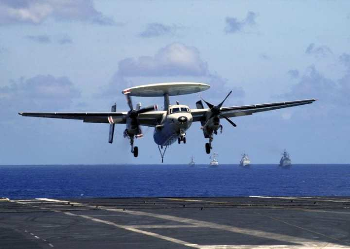 An E-2C Hawkeye from the Sunkings of Airborne Early Warning Squadron 116 (VAW-116) comes in for a recovery aboard USS Constellation (CV 64) with one engine after having an in-flight emergency May 28, 2003. VAW-116 was returning from a deployment with the Constellation Battle Group in which it supported Operations Southern Watch, Enduring Freedom and Iraqi Freedom. U.S. Navy photo by Photographer's Mate 2nd Class Daniel J. McLain.