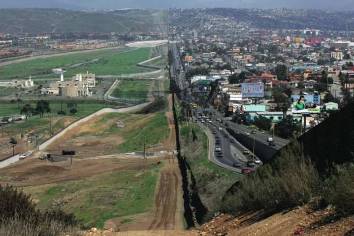 The U.S./Mexican border: The United States is on the left side of the photo. DHS is using American Recovery and Reinvestment Act funding to improve security at land ports of entry and along borders. ICE photo by Gerald Nino.