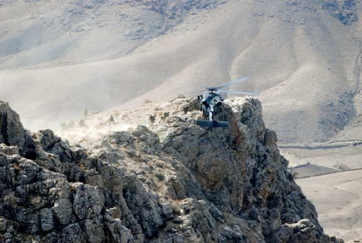 U.S. Special Forces are extracted from a mountain pinnacle in Zabul province, Afghanistan by a U.S. Army UH-60 Black Hawk helicopter from Company A, 2nd Battalion, 82nd Aviation Regiment, 82nd Combat Aviation Brigade after executing an air assault mission to disrupt insurgent communications. U.S. Army photo by Staff Sgt. Aubree Clute.