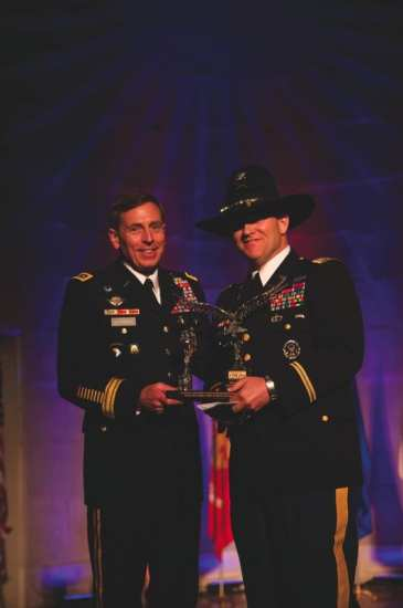 First Annual Freedom Award winner Col. David Sutherland presenting Gen. David Petraeus the No Greater Sacrifice Foundation's 2nd Annual Freedom Award on May 5th, 2009. NGS photo.