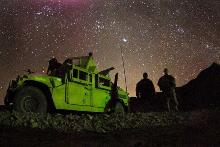 U.S. Army Spc. Stephen Highberger, left, and Pvt. Charles Joiner from Bravo Company, 1st Battalion, 4th Infantry Regiment, U.S. Army Europe, sit in a patrol base on an overnight mission near Forward Operation Base Lane, Zabul Province, Afghanistan, March 13, 2009. U.S. Army photo by Staff Sgt. Adam Mancini.