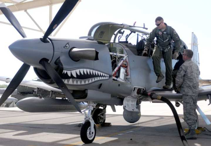 Maj. Jesse Smith exits a Hawker Beechcraft AT-6C after testing the light-attack aircraft's ability to perform a combat search and rescue mission Oct. 7, 2010, at Davis-Monthan Air Force Base, Ariz. Smith was one of several pilots invited by the Air National Guard Air Force Reserve Command Test Center to fly the experimental airplane and provide recommendations for improving its capability. Smith is an A-10 pilot from the 422nd Test and Evaluation Squadron at Nellis Air Force Base, Nev. U.S. Air Force photo by Maj. Gabe Johnson.